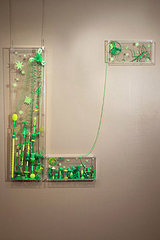 Title: Fais le lien - Recycled plastic and found object sculptures by Diana Boulay - made of discarded plastic objects - Colorful art that makes you reflect upon society's waste mismanagement