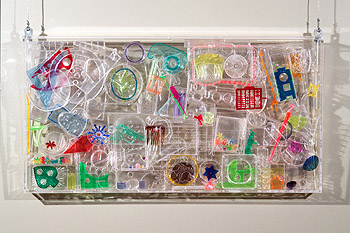 Title: Mon cotillon - Recycled plastic and found object sculptures by Diana Boulay - made of discarded plastic objects - Colorful environmental artwork